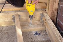 Drive Tapcon screws into stoop
